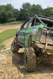 Green off-road car on a steep slope Stock Images
