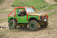 Green off road car in the tarrain Stock Photos