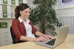 Green office: business woman working Royalty Free Stock Image