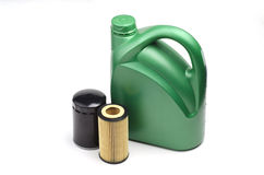 Green oil canister and oil filters. Image of oil canister and oil filters Royalty Free Stock Images
