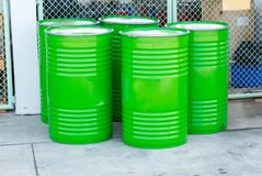 Green oil drums on an industrial site Stock Images