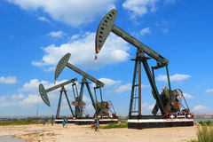 Green Oil pump of crude oilwell rig Stock Photography