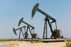 Green Oil pump of crude oilwell rig Royalty Free Stock Photos