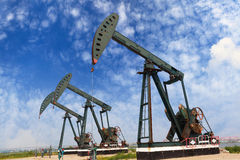 Green Oil pump of crude oilwell rig Stock Photo
