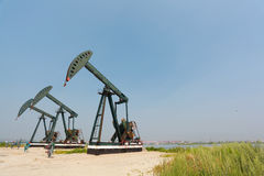 Green Oil pump of crude oilwell rig Royalty Free Stock Image