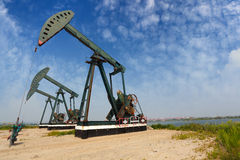 Green Oil pump of crude oilwell rig Royalty Free Stock Photo