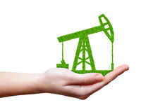 Green oil pump in hand Stock Photo