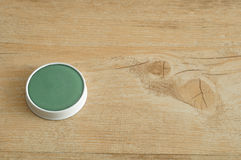 A green ointment in a white tin Stock Photos