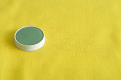 A green ointment in a white tin Royalty Free Stock Photos