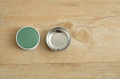 A green ointment in a white tin with a silver lid Royalty Free Stock Photo