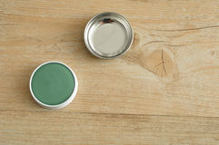 A green ointment in a white tin with a silver lid Stock Image