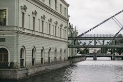 Green old building facade on a canal shore in Saint Petersburg stock image