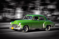 Green old car, Havanna Cuba. Black-white background royalty free stock photography