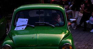 One little boy sit in green old car. Green old car It returns us in old times.Travel in the past century Peace trip Royalty Free Stock Image