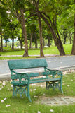 Green old chair in park Stock Photo