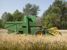 Green old combine harvester Stock Photo