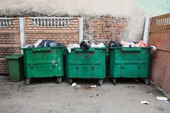 Green containers with garbage. Green old containers with garbage Royalty Free Stock Photo