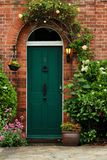Green Old Door on a brick wall Royalty Free Stock Images