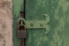 Green old door with a lock Stock Images