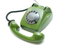 Green old-fashioned telephone. On white background stock image