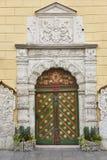 Green old fashioned wooden door on stone facade. Tallinn Stock Photography