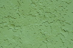 Green old painted metal texture close up. Metal surface painted green. Peeling paint, many old layers Royalty Free Stock Images