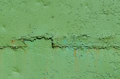 Green old painted metal texture. Metal surface painted green. Peeling paint, many old layers Stock Photography