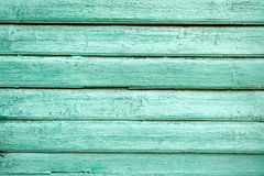 Green old painted wooden door texture as background Royalty Free Stock Photo