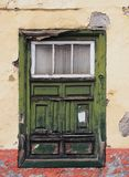 Green old shabby window in a decaying house with weathered wood Royalty Free Stock Images