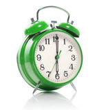 green old style alarm clock  on white Stock Photos
