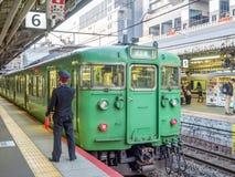 Green old train at Arashiyama station, Japan. KYOTO, JAPAN - NOVEMBER 24 : Green car classic train from Kyoto station stops at Arashiyama train station in Kyoto Stock Photography