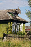 Green old wooden house with carved trims Stock Photos