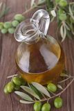 Green olive and carafe Stock Photography