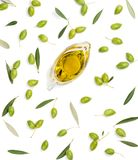 Raw olives and olive oil. Green olive fruits with leaves and olive oil isolated on white background, top view stock image