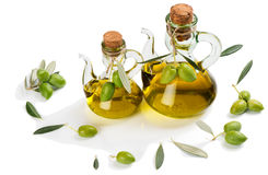 Green olive fruits and olive oil. Royalty Free Stock Image