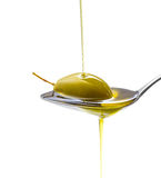 Green olive in full oil spoon, isolated Royalty Free Stock Photos