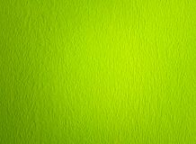 Green olive grainy textured wall background stock image
