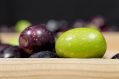 Green olive beside other ones with different colors Stock Photography