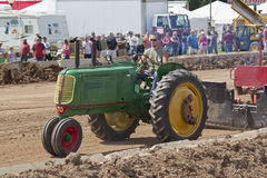 Green Oliver Tractor pulling Stock Image