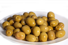 Green olives. On the table Royalty Free Stock Photos