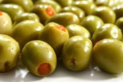 Green olives. Stuffed with red pepper Stock Photography