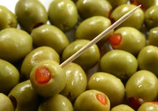 Green olives. Stuffed with red pepper Stock Photo