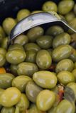 Green olives. With peppers royalty free stock photos