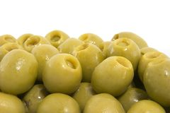 Green olives. A collection of green olives on white background Royalty Free Stock Image