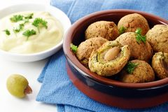Green olives baked in parmesan dough with a creamy garlic dip, f Stock Photography