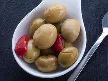 Green olives on black surface Stock Image