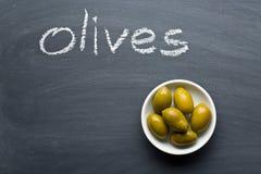 Green olives on blackboard Royalty Free Stock Photo