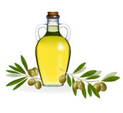 Green olives with bottle of olive oil. Stock Photos
