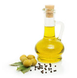 Green olives and a bottle of olive oil. Green olives, bottle of olive oil and black pepper Stock Image