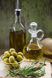 Green Olives and Bottles of Olive Oil Royalty Free Stock Photos